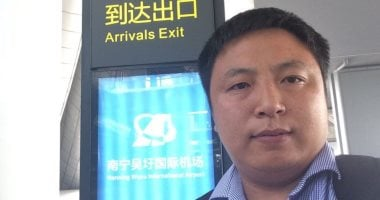 Chinese human rights lawyer defies his travel ban, reaches United States