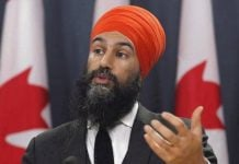 Canadian NDP leader threatens to vote against government in the throne speech